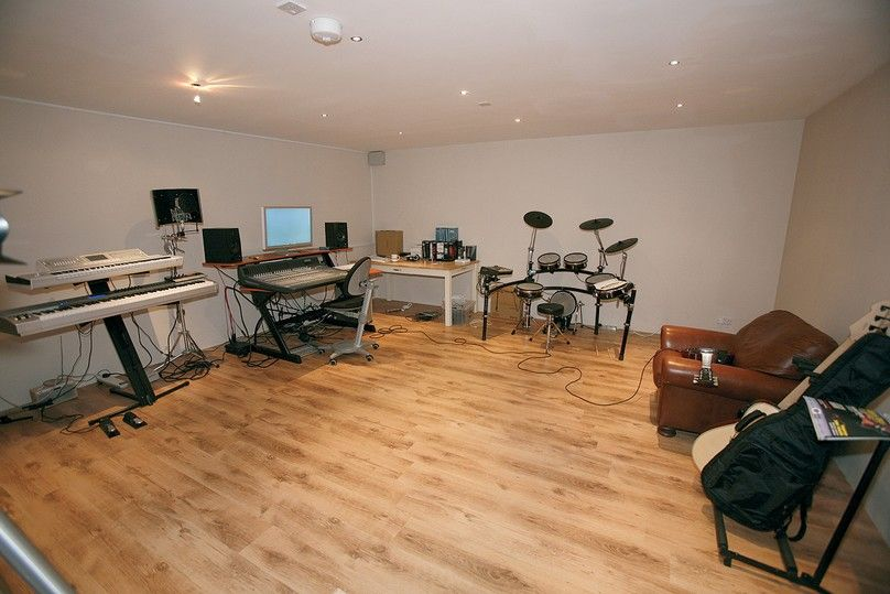 decorating home music studio basement with recessed lighting and wooden flooring home music studio