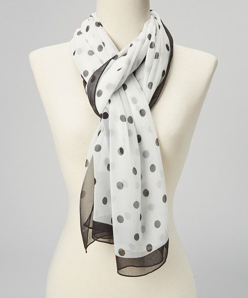 Achieve that timeless look with this perfectly posh scarf. The dainty construction and classic color combination come together for a sophisticated piece that will gracefully tie together any luxe look.