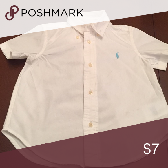 Polo button down for toddler! White polo button down for toddler. Light blue horse. Minor marking on right side. Reflected in price Shirts & Tops Button Down Shirts
