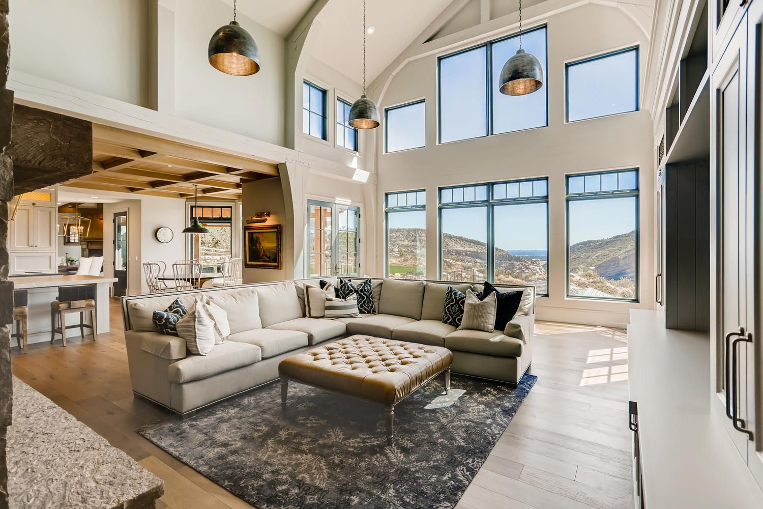 An amazing ranch style living room high in the colorado mountains! A perfect gettaway for the busy city goer. #customhome #customarchitecture #customresidential #residentialarchitecture #residentialarchitect #interiordesign #interiorarchitecture #coloradoarchitecture #coloradoarchitect #denverarchitecture #denverarchitect #goddensudik #decor