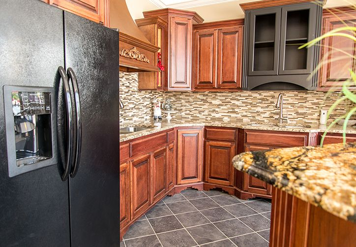 Traditional Kitchen With Warm Toned Granite Countertops And Stacked Glass  Tile Backsplash