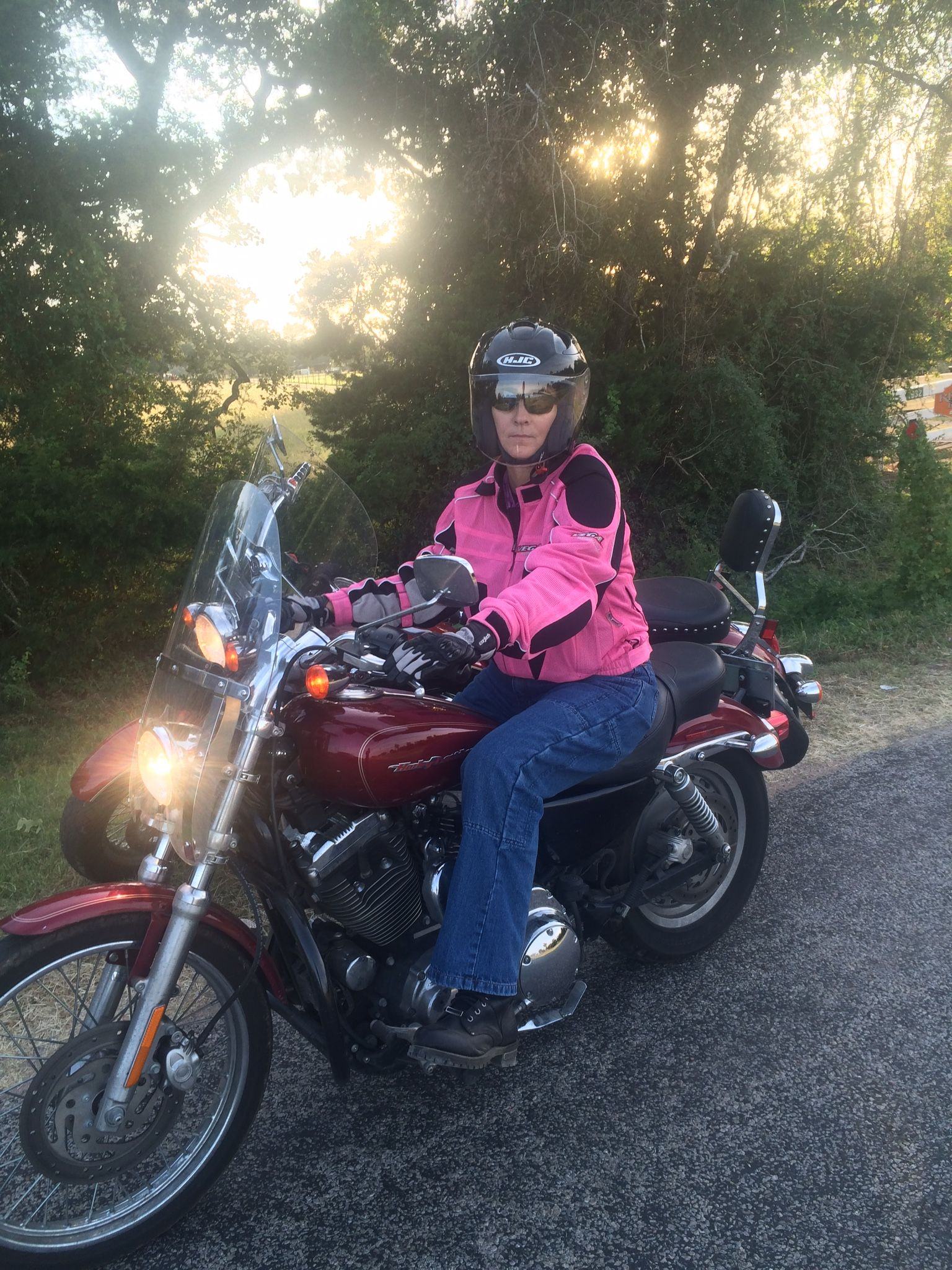 Texas lady biker riding a 2004 Harley Sportster 1200 Custom