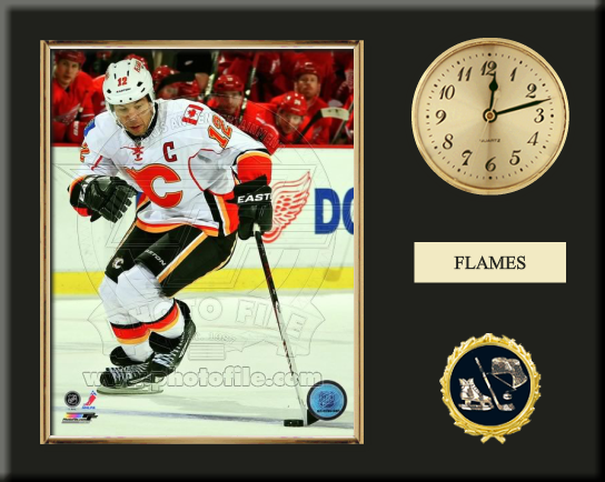 One 8 x 10 inch Calgary Flames photo of Jarome Lginla inserted in a gold slide-in frame and mounted on a 12 x 15 inch solid black finish plaque.  Also features a 3-inch Arabian gold-faced clock, a customizable nameplate* and a 2-inch hockey medallion with a gold base.  $59.99 @ ArtandMore.com