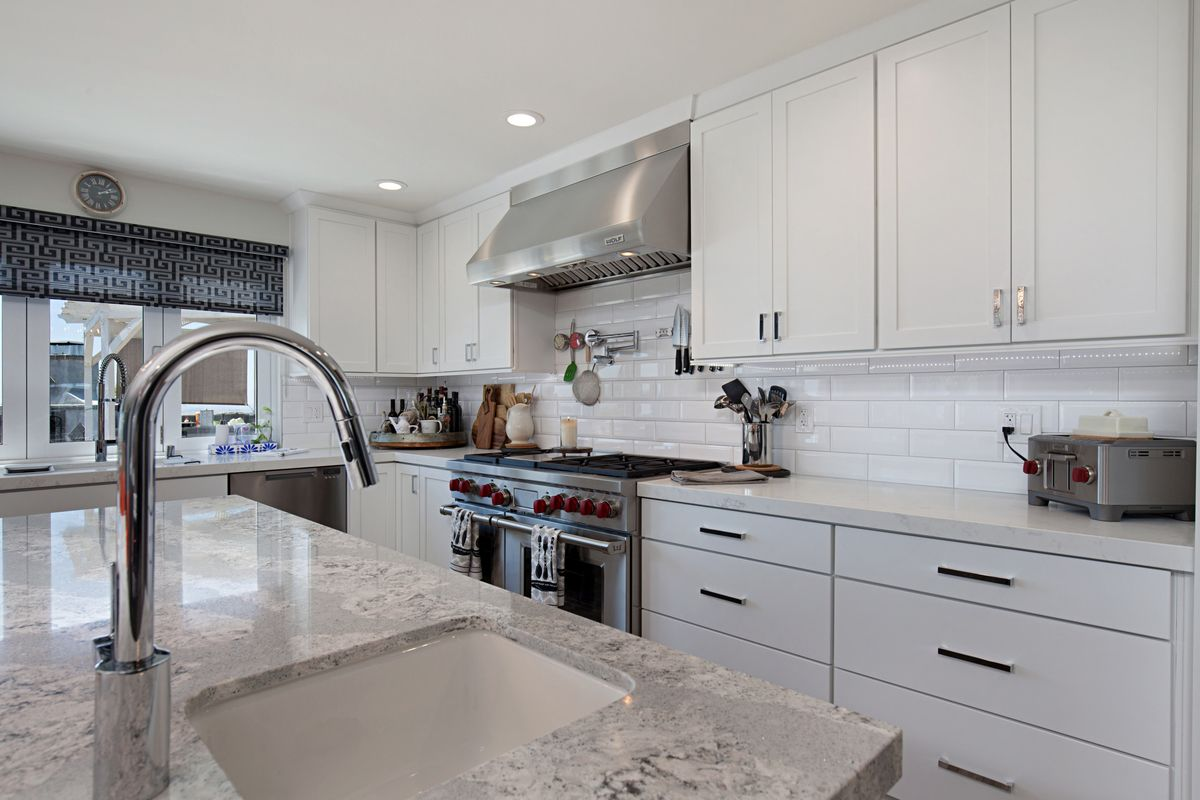 This White Kitchen Remodel Is Stunning Features Msi Calcatta Vicenza Quartz Countertops A Simple Kitchen Remodel Cheap Kitchen Remodel Kitchen Remodel Layout