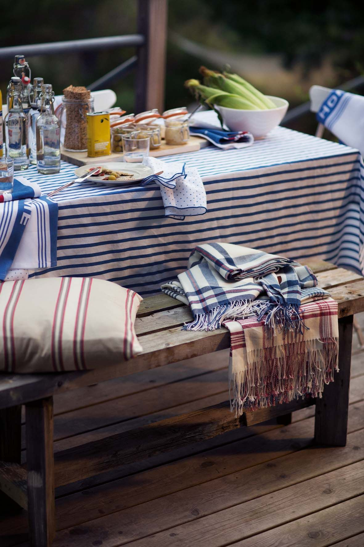 Striped Tabelcloth On A Rsutic Style Outdoor Table