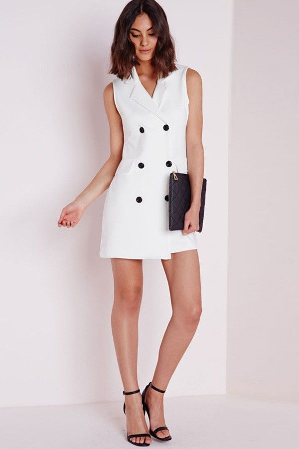57310277d96 Look fierce this season in this white blazer dress. In a figure flattering  this white number with oversized black button feature is chic.