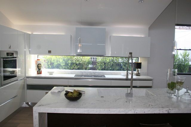 Using A Window As A Splashback Adds Natural Light And Creates The Illusion Of Space In The Kitchen Modern Kitchen Window Modern Kitchen Kitchen Design