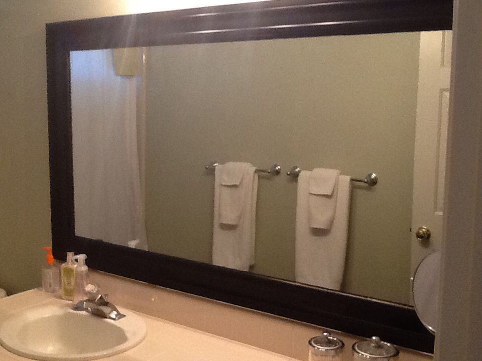 framed the guest bathroom mirror two pieces of baseboard from lowes rustoleum spray paint. Black Bedroom Furniture Sets. Home Design Ideas