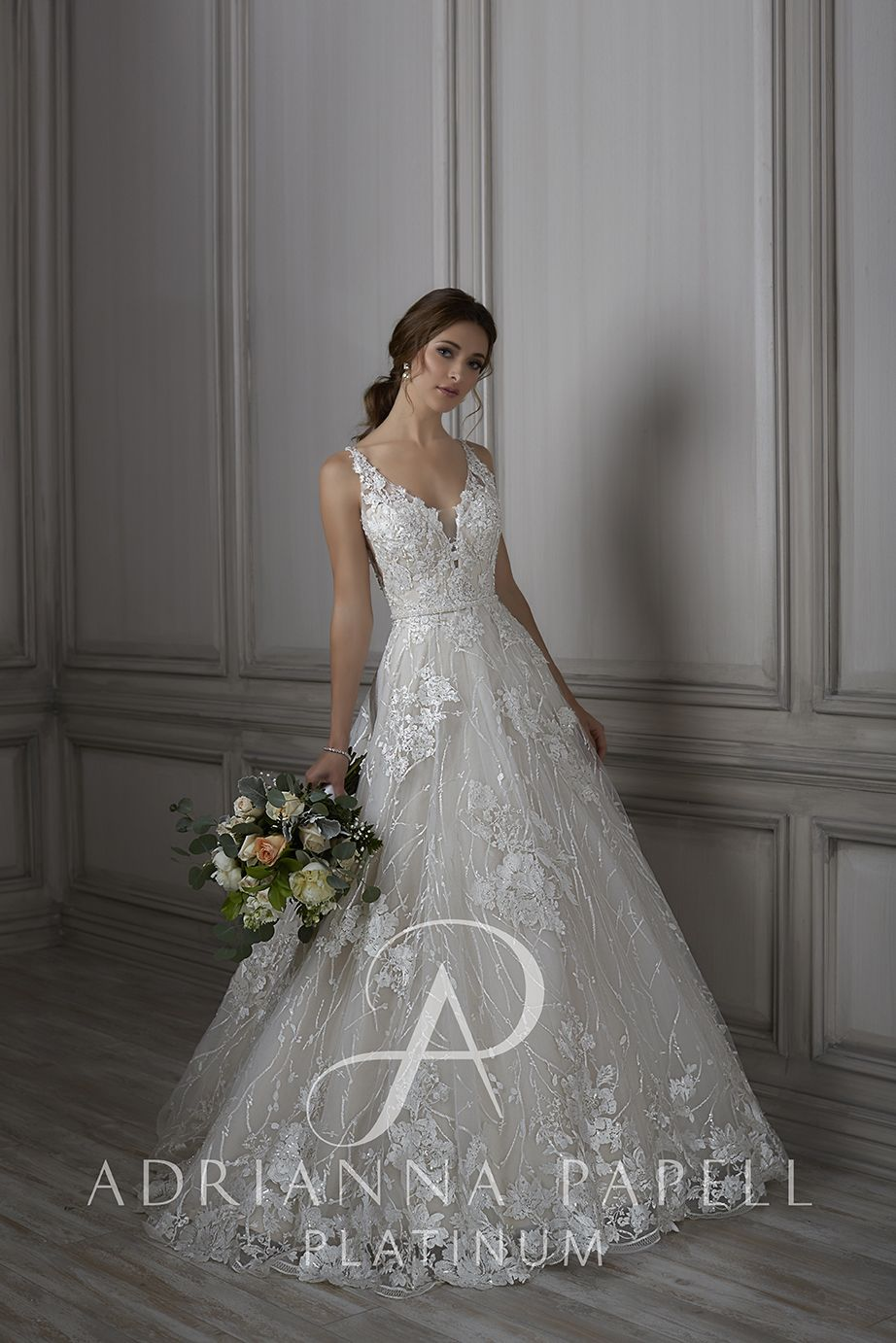 This adrianna papell louisa aline bridal gown is styled in