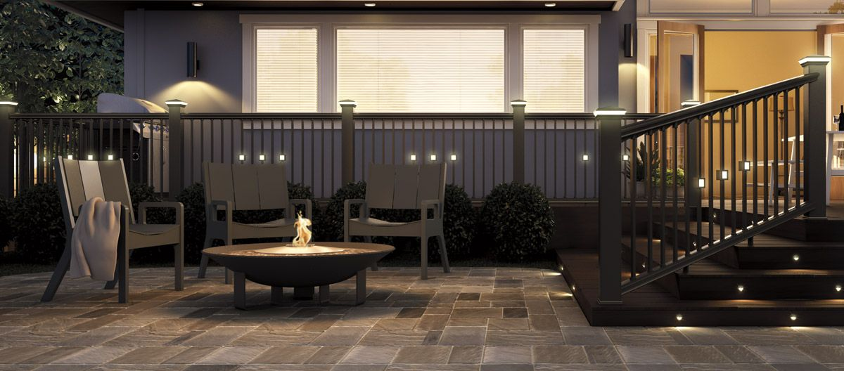 Lighting By Deckorators Recessed Lighting Kit In Stairs Square Lit Balusters And Solar Postcaps Deckorators Deck Lighting Solar Deck Lights