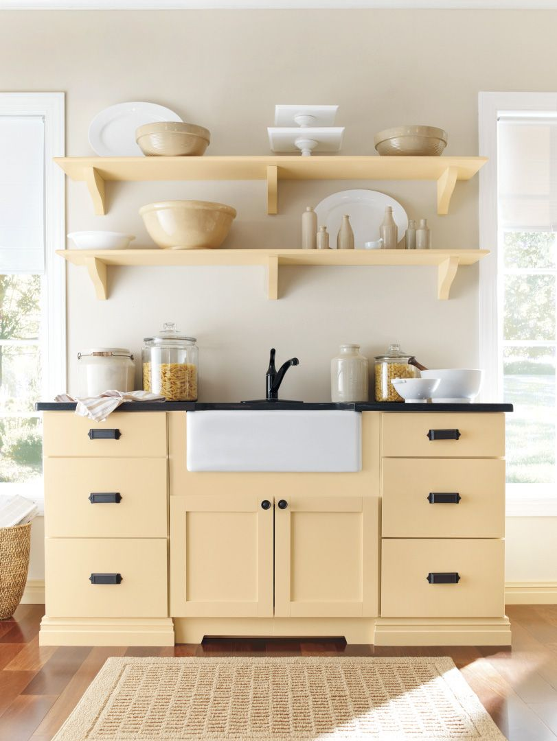 Open shelving and a farmhouse sink create a clean kitchen. #kitchens ...