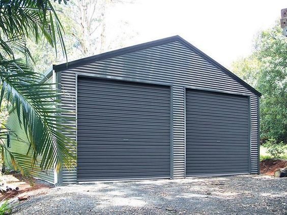 Double Garage With Horizontally Cladding 7m X 7m X 3m Genuine Colorbondsteel With Basalt Walls Woodland Grey Doors Double Garage Garage Design Cladding