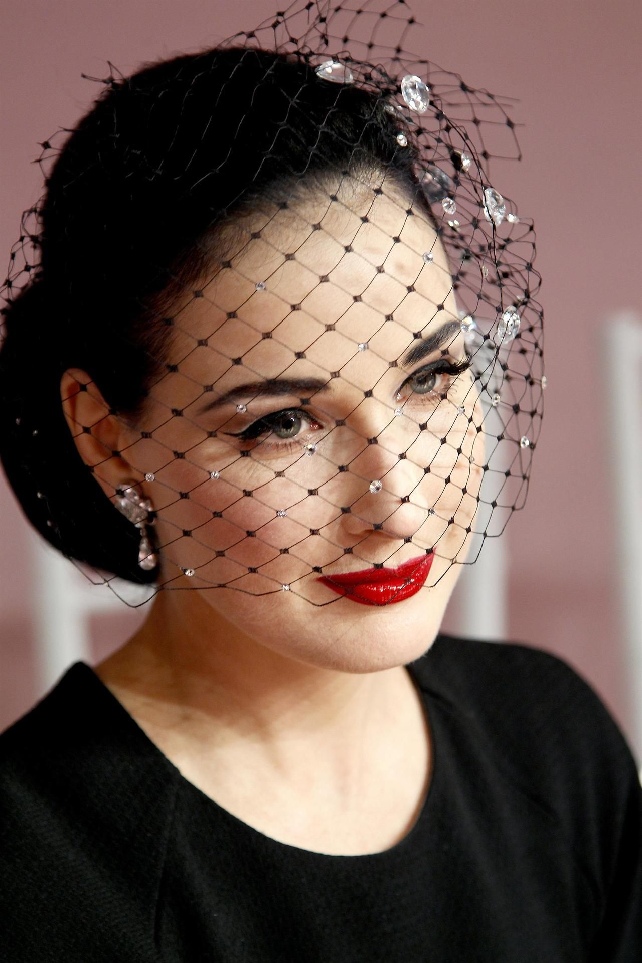 Dita Von Teese black netting is so simple but so dramatic