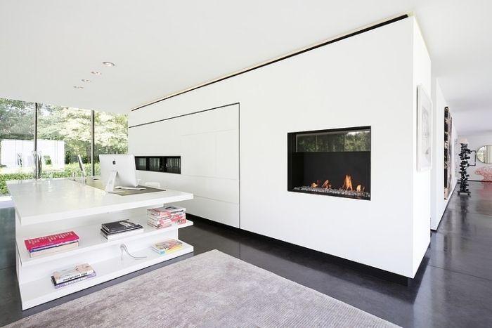 wohnzimmer-wohnwand-weiß-integriert-regale-stauraum-kamin-home-ofice