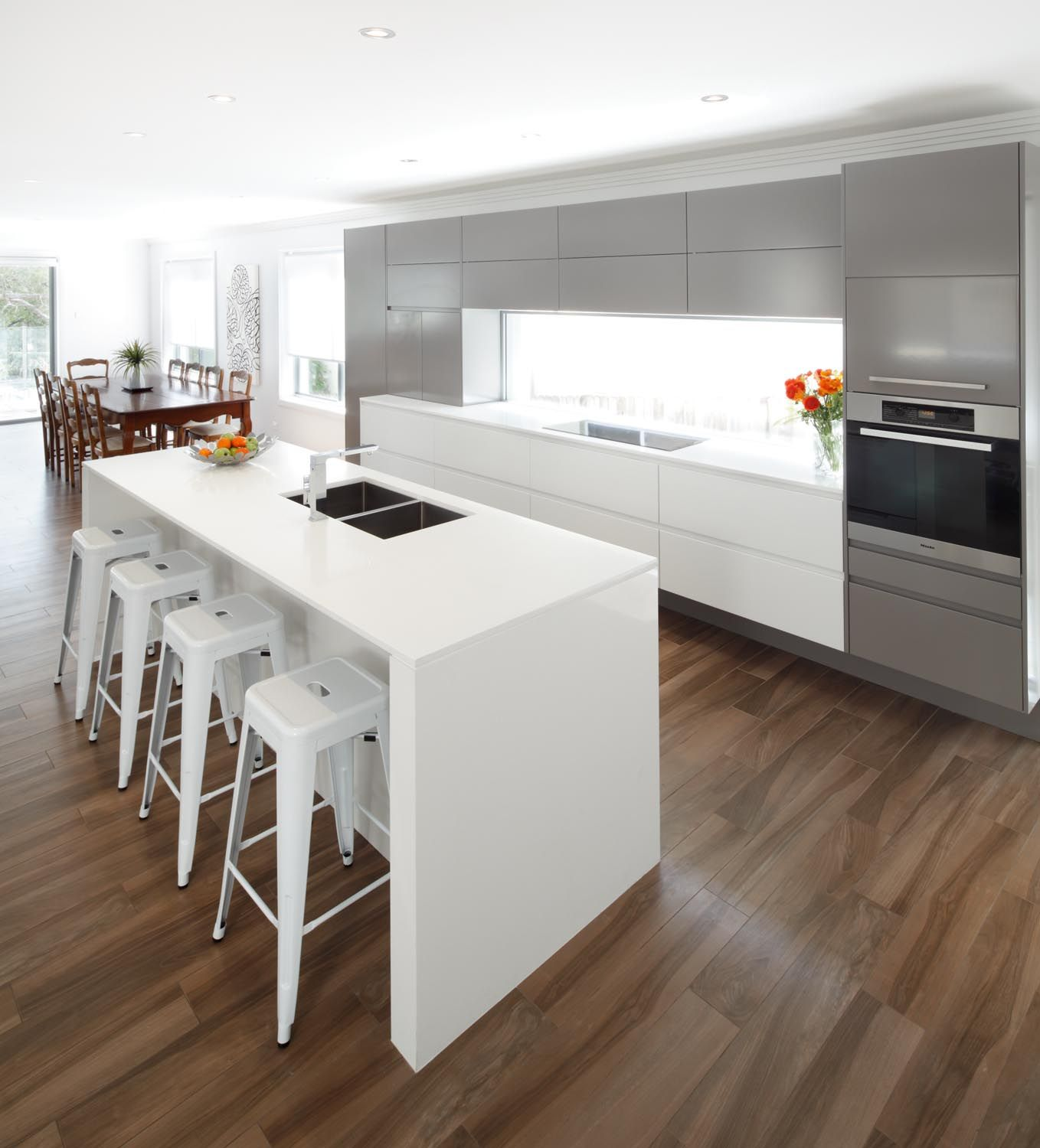 this sleek modern kitchen design incorporates white silver and beautiful timber flooring on kitchen decor themes modern id=53936