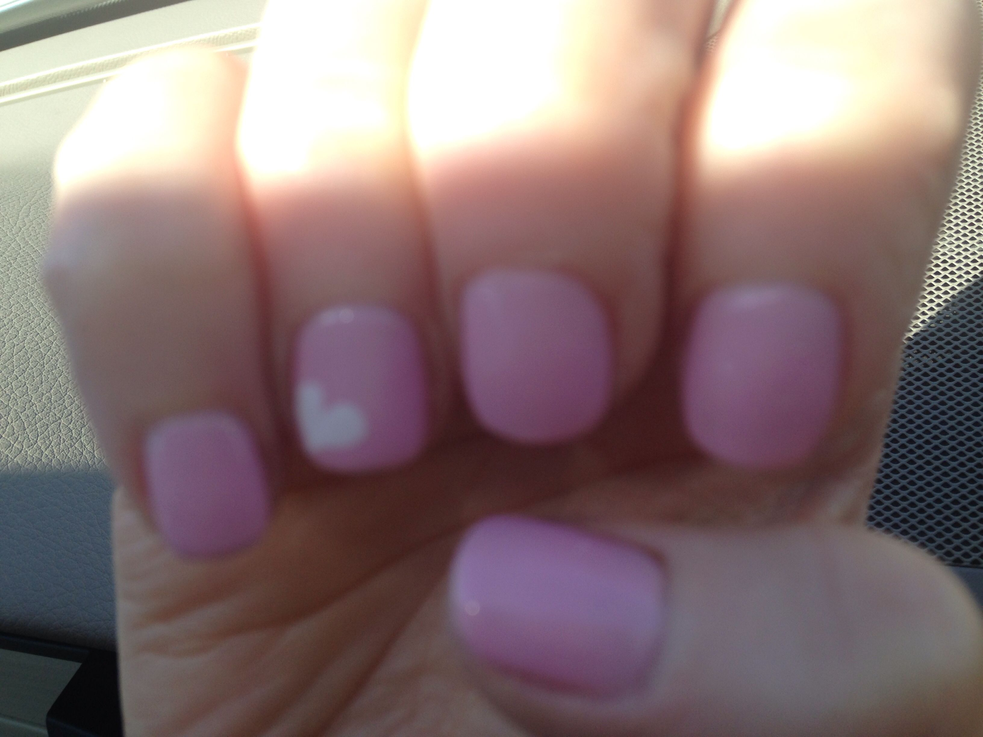 Gel nails..(: light pink base with a white heart design on the ...
