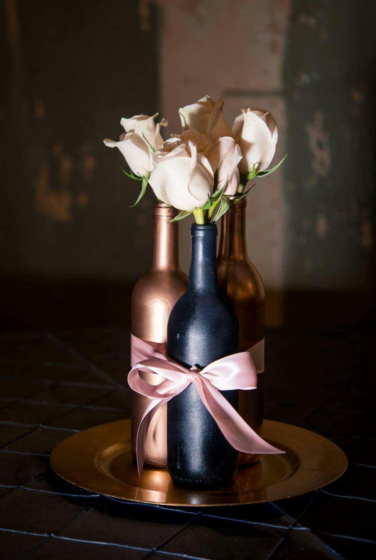 Designed By Bethany S Bouquets Wine Bottle Centerpiece For Wedding Roses Blush B Wine Bottle Wedding Centerpieces Bottle Centerpieces Wedding Wine Bottles