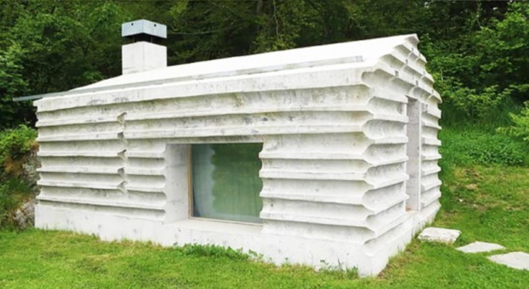Concrete Log Cabin, Graubünden, Switzerland by Nickisch Sano Walder Architekten.