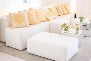 In contrast to the stormy skies outside, summery indoor lounge areas were decorated to match the iconic buttery yellow color of the moisturizer. The modular white lounge seating was provided by Taylor Creative Inc.