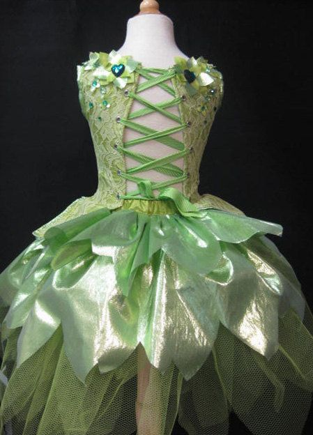 KIDS size awesome tinkerbell style fairy costume with 3-d details and tons of rhinestones and sparkle. $235.00, via Etsy.