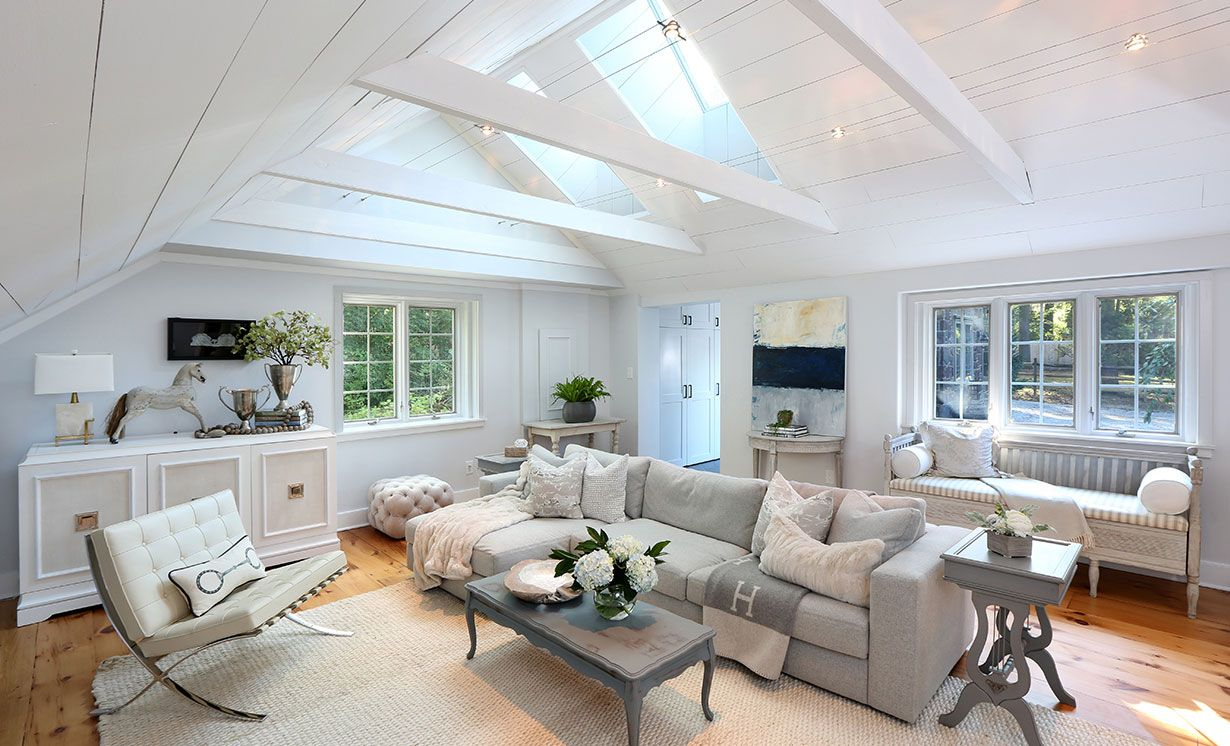 The exposed cathedral ceiling with shiplap boards and the antique ...
