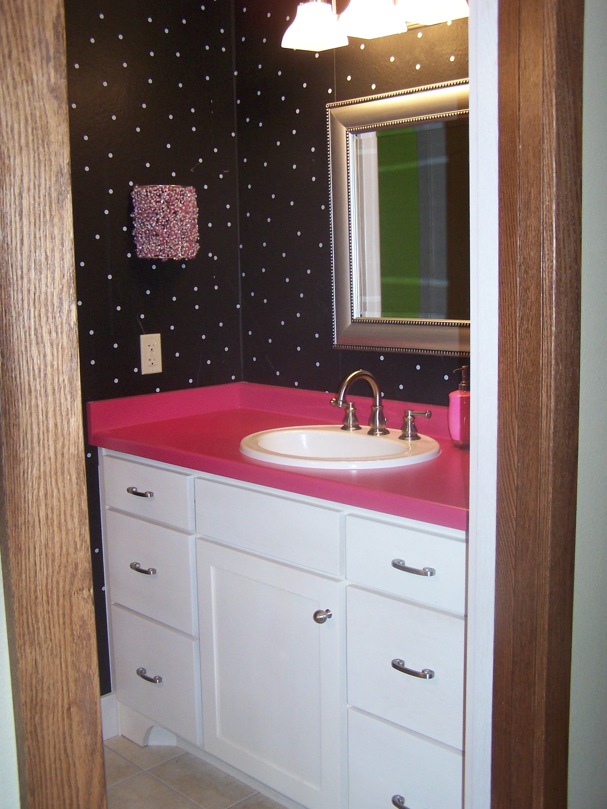 Girls Bathroom With Hot Pink Laminate Countertops And White Cabinets By  Swita Cabinetry.