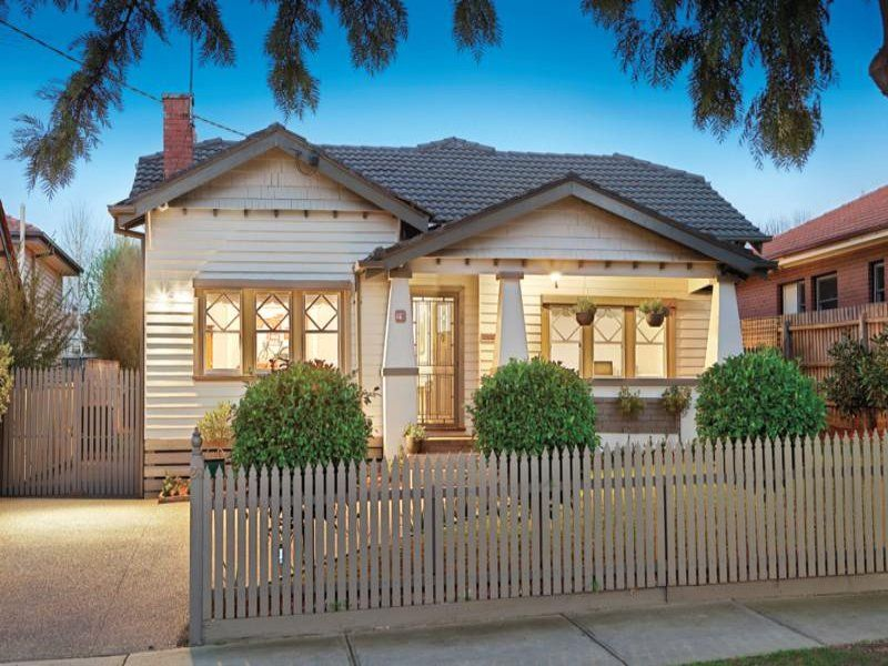 Weatherboard californian bungalow house exterior with picket fence