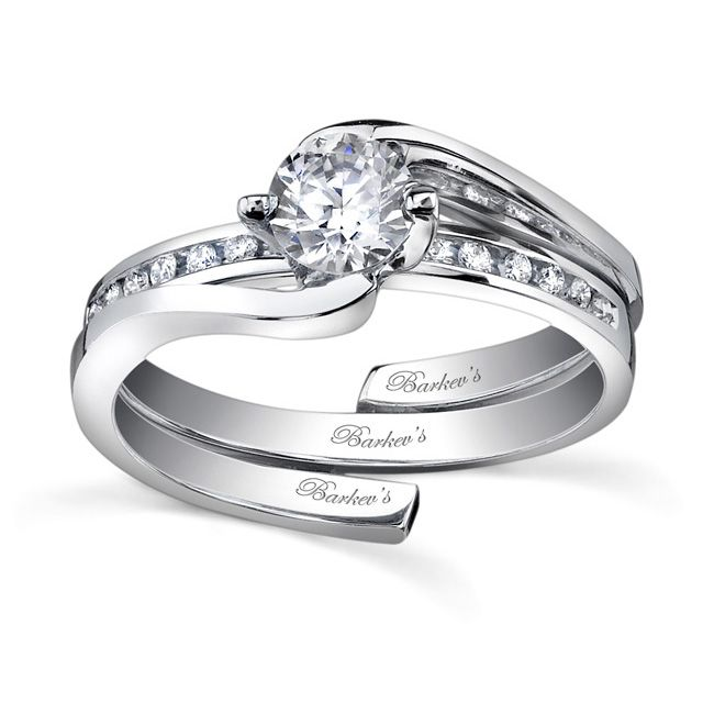 Featuring A Channel And G Set Round Center Diamond Bridged At The Bottom Of Shank To Slip Wedding Ring In Place Band Is Adorned