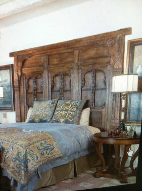 Distressed headboard and footboard made from two old doors
