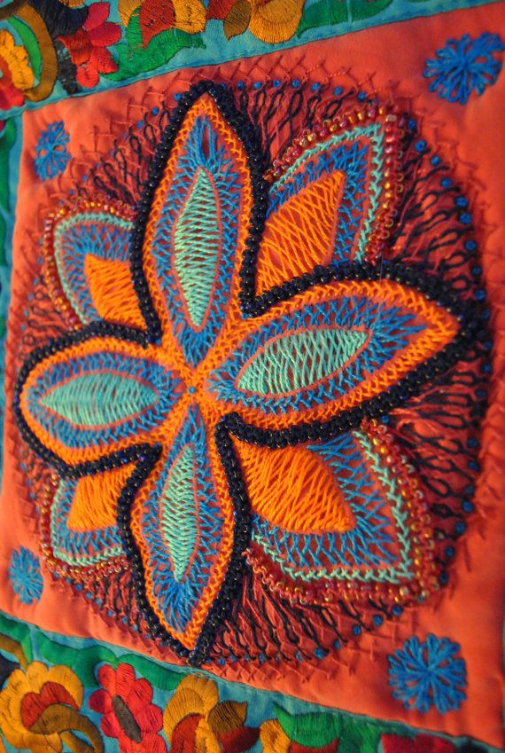 Available on etsy. Vivid little art quilt, influenced by Indian textiles .... hand-embroidered on red silk, the central floral motif evokes mandalas, the edges carefully hand-beaded in bright jewel colours that echo the bold, shimmering perle thread and pick up the stunning colours in the vintage sari trim.