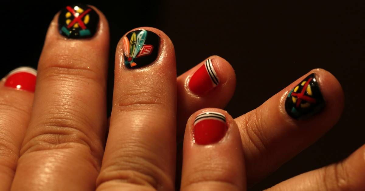 Nail artist paints blackhawks designs for customers nail