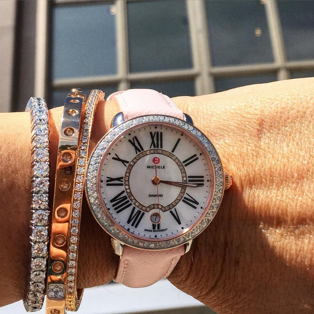 We're having an arm party with our Michele Serein watch and diamond bracelets. Does anyone recognize the windows in the photo? #AlsonOutAndAbout #MicheleWatches #rosegold #diamonds #pinkstrap #style #fashion #Cleveland #AlsonJewelers