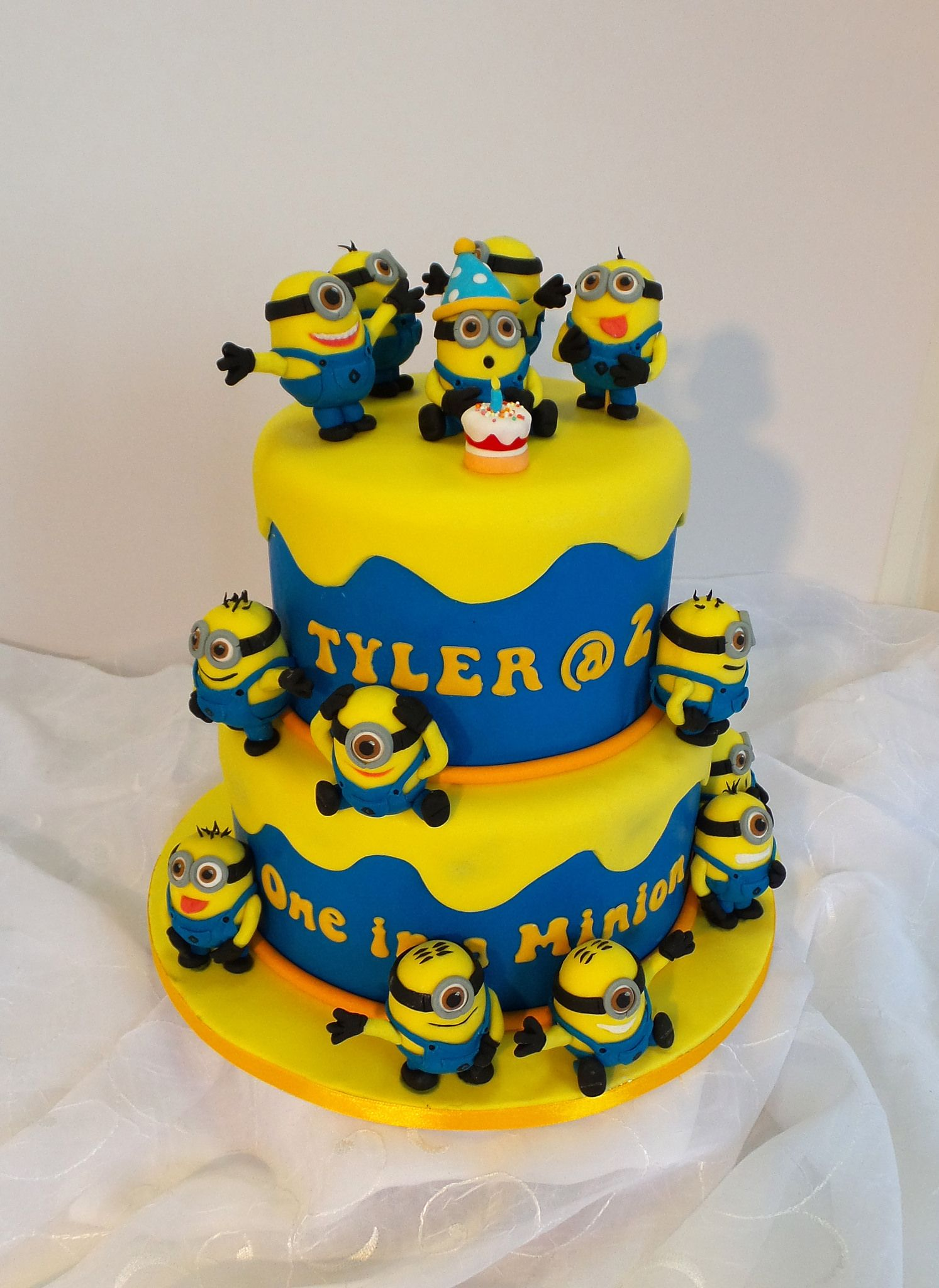 Fabulous Two Tier Minion Themed Birthday Cake With Images Minion Cake Funny Birthday Cards Online Inifodamsfinfo