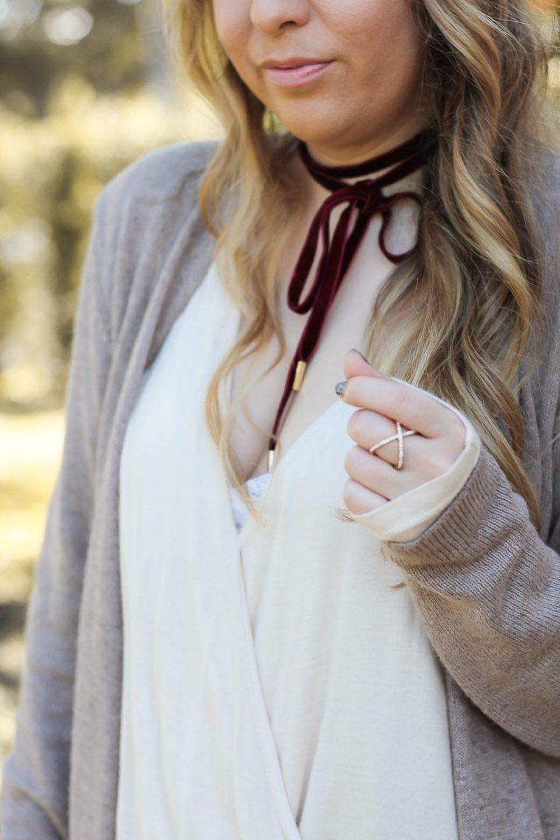 cd7408bf2e Miami fashion blogger Stephanie Pernas styles a burgundy velvet choker with  a cozy cardigan