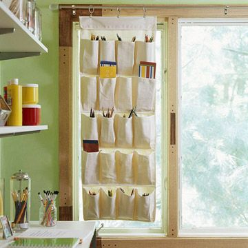 A hanging canvas shoe organizer becomes a functional window treatment.