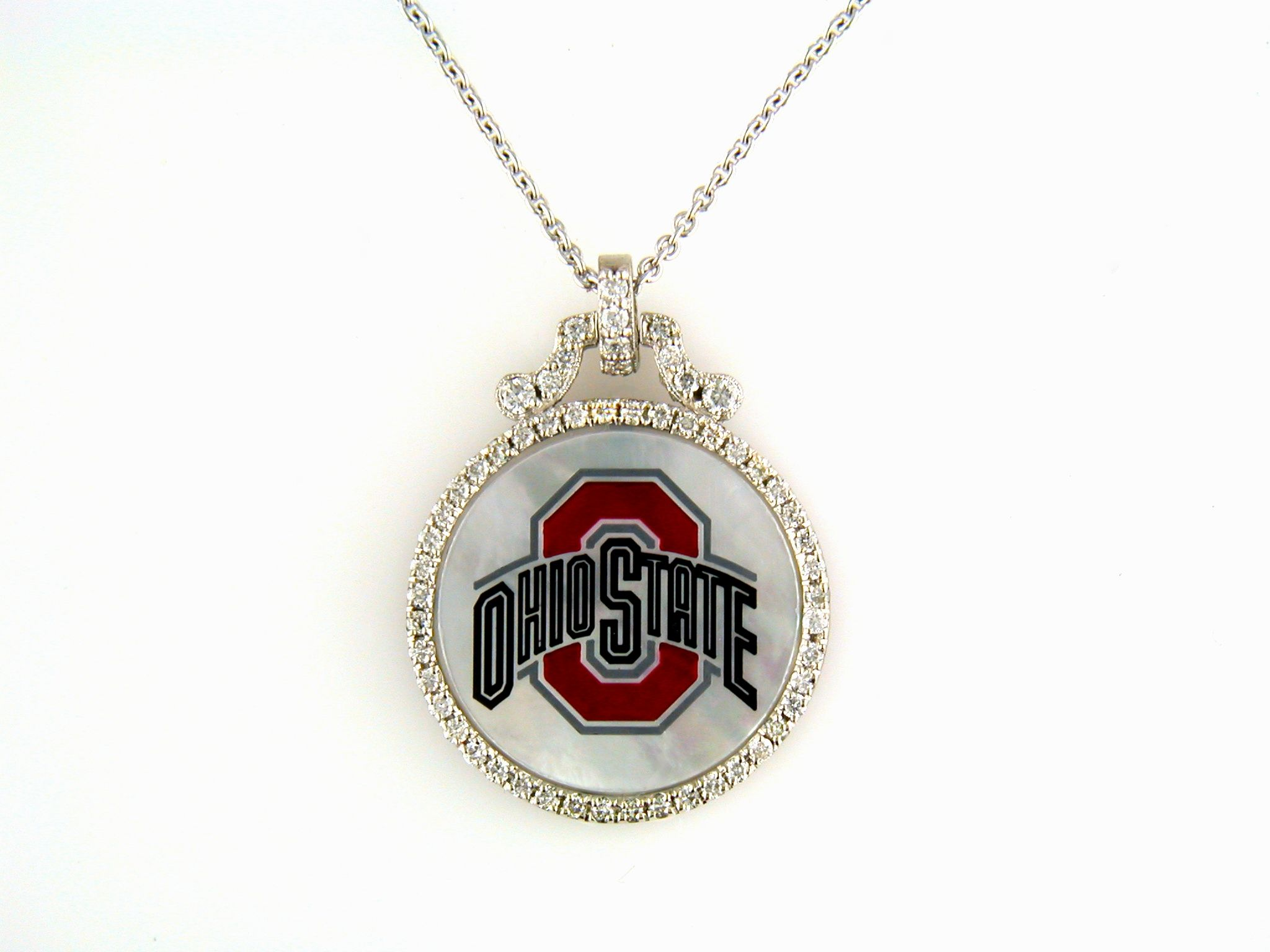 Oh, darlings, it's football season! 14k white gold with diamonds in mother of pearl and the logo of the best team ever, Go Bucks!