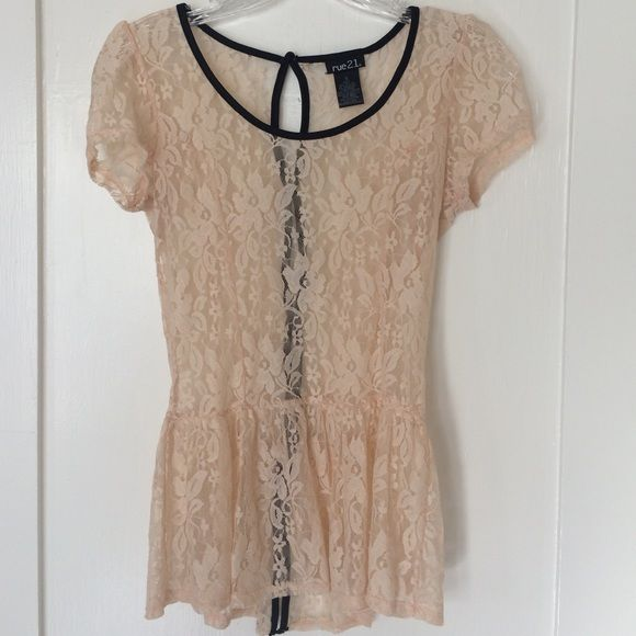 Rue 21 romantic peach lace button back peplum top Beautiful romantic lace peplum top by rue 21. Color is a soft peach with black trim and buttons in the back. From pet and smoke free home in great condition. Rue 21 Tops Blouses