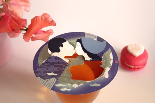 Love birds on cup of tea