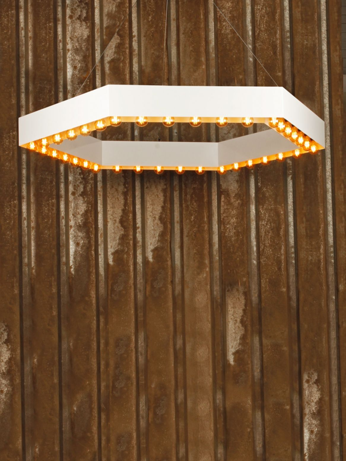 Bespoke feature ceiling pendant light with a white hexagonal ring
