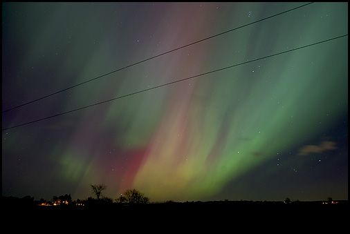 Photographed by me.  Too bad for the hydro wires, but it shows you just how overwhelmingly huge the auroras were that night.  They covered the entire skyline, almost 360 degrees.  In fact, they came to a corona up above in the middle.  See next photo.