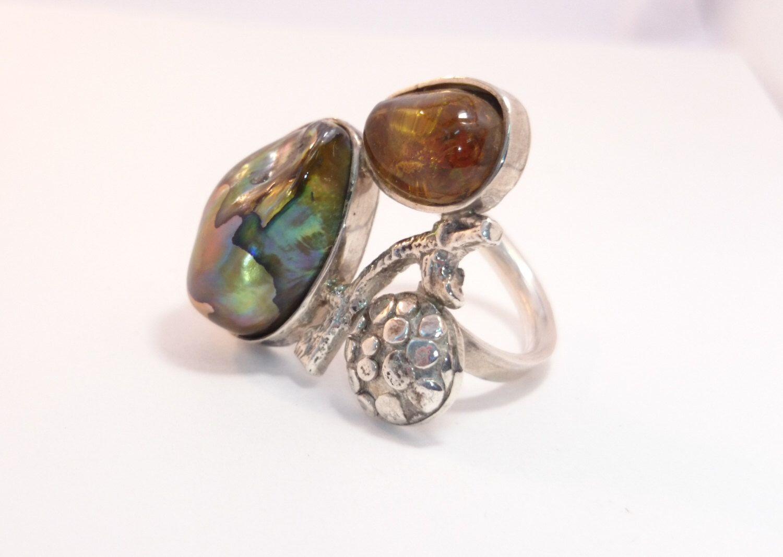 Anillo de Plata Ámbar y Perla Cultivada de ogatoconjoyas en Etsy https://www.etsy.com/es/listing/260004314/anillo-de-plata-ambar-y-perla-cultivada