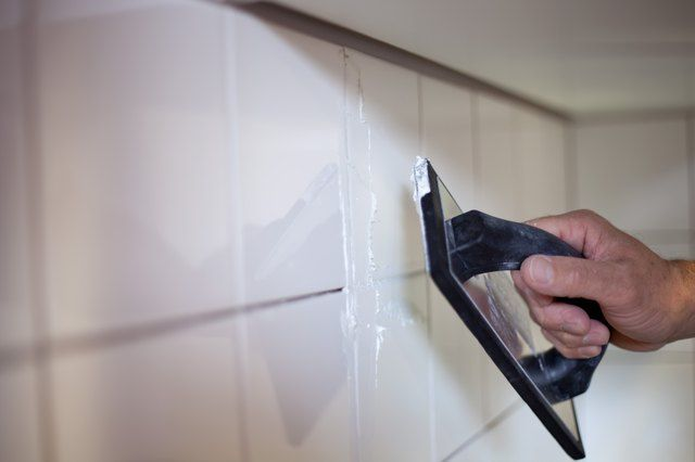 Can You Put New Grout on Top of Old Grout  is part of Bathroom grout, Floor grout, Grout, Ceramic wall tiles, Removing grout from tile, Tile installation - Removing the grout from a floor, shower wall or countertop can be timeconsuming and cause cracks in the tile  Placing new grout over old grout gives you a solid area to work within and without loose tiles making the job a big mess  Spruce up dingy shower walls or floors with grout over grout