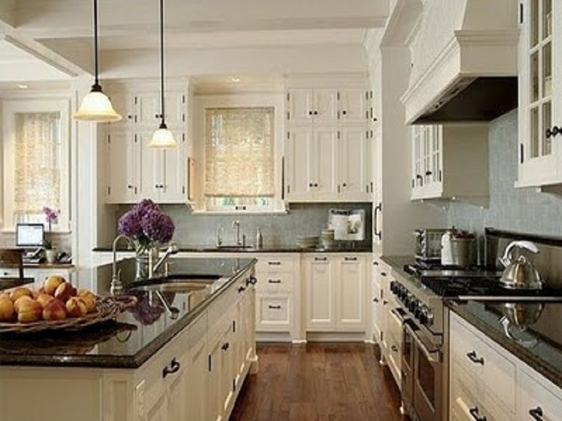 Great soothing kitchen design with white cabinets and dark for Black and white kitchen cabinet designs