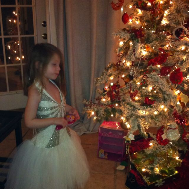 My favorite angel in my prom dress by the flocked Christmas tree