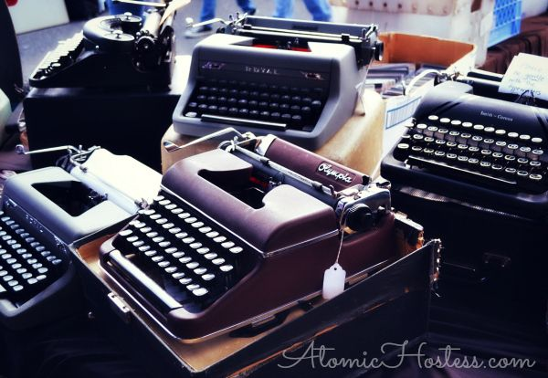 Vintage typewriters all lined up in a row. Would be fun to have one to type an actual letter.