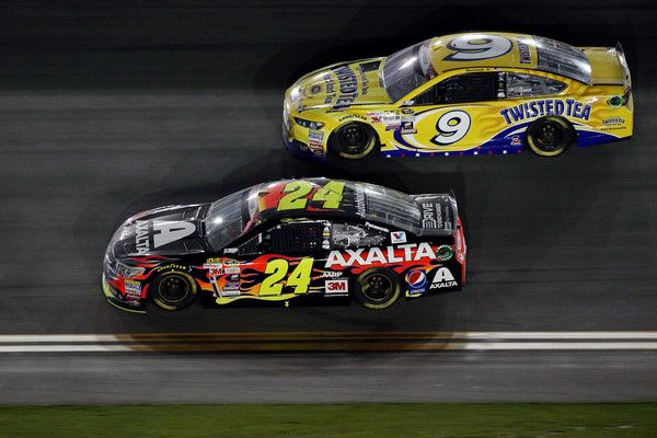 Jeff Gordon Photos Photos - Jeff Gordon, driver of the #24 Axalta Chevrolet, leads Sam Hornish Jr., driver of the #9 Twisted Tea Ford, during the NASCAR Sprint Cup Series Coke Zero 400 Powered by Coca-Cola at Daytona International Speedway on July 6, 2015 in Daytona Beach, Florida. - NASCAR Sprint Cup Series Coke Zero 400 Powered By Coca-Cola