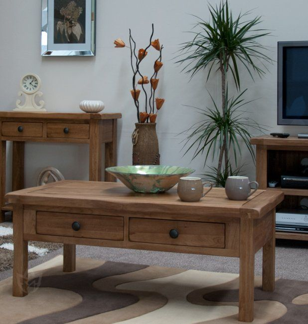 The tones of these coffee table look great with plants and ...