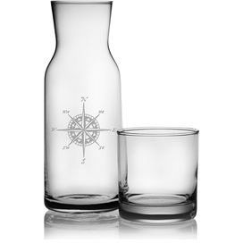 "Enjoy crisp cocktails with this chic carafe set, or place it by your bed to keep ice water on hand. Showcasing a sand-etched compass motif, this eye-catching design makes a stylish statement.   Product: Carafe and glassConstruction Material: GlassColor: ClearFeatures:  Sand-etched design27.5 Ounce carafe capacity11 Ounce glass capacity Dimensions: Carafe: 8.5"" H x 3.25"" DiameterGlass: 3.125"" H x 3.5"" Diameter"