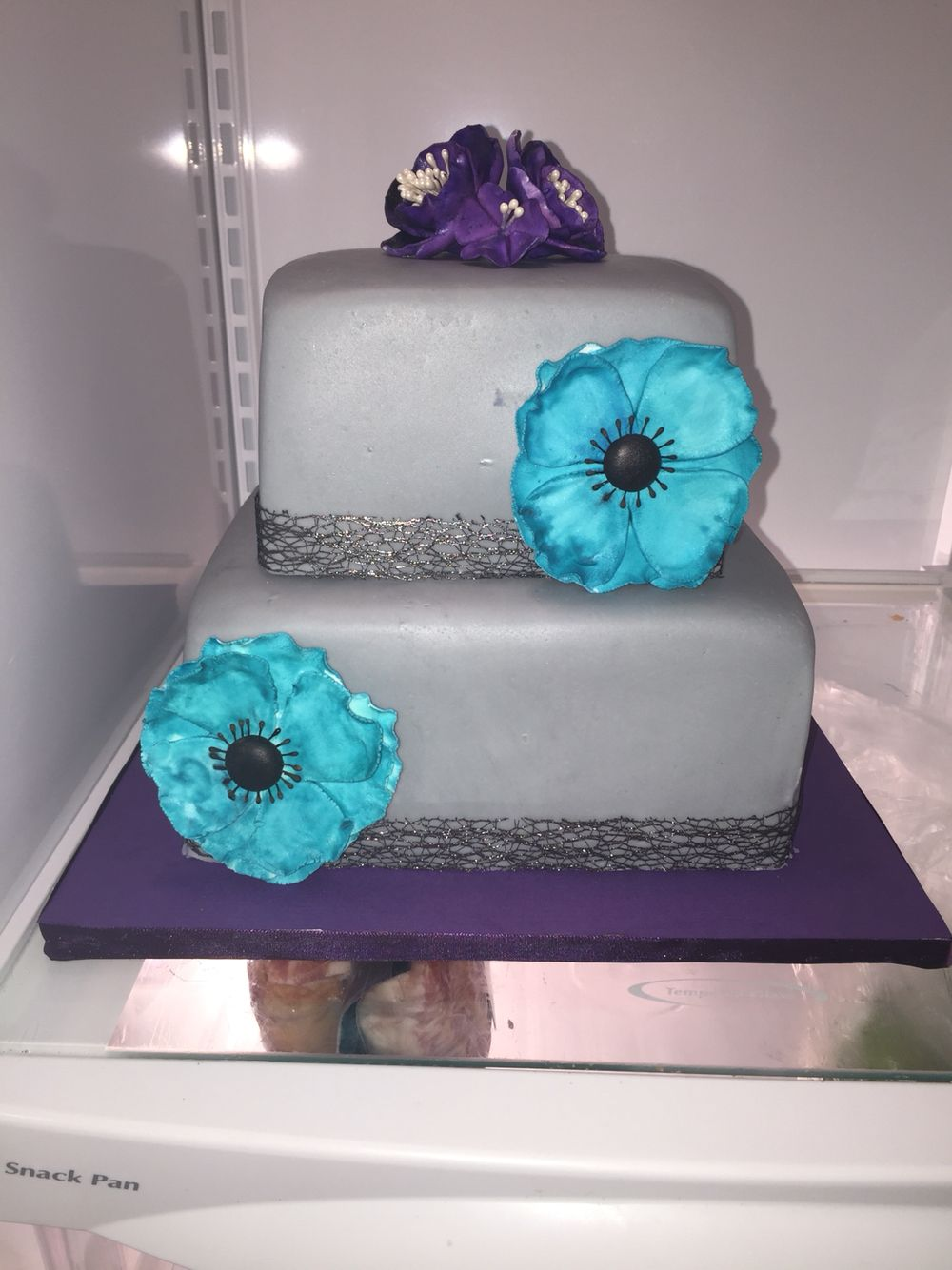 Grey, purple, and teal cake