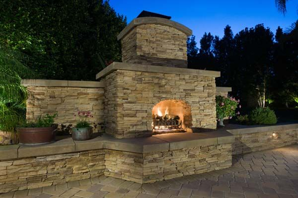 Let us help create an outdoor fire place that fits in with your home! #YardIllumination http://yardillumination.com/